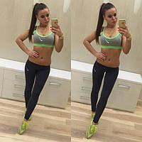 Яркий спортивный костюм для спорта и фитнеса Nike: яркий топ и леггинсы
