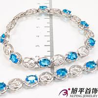 Браслет родиумный Овальные бирюзово/белые камни в 4х держателях, металлические цветочки
