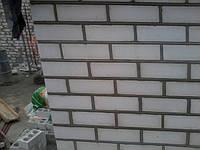 Бригада каменщиков построит дом в Херсоне