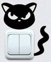 Виниловая интерьерная наклейка - Кошка на розетку 2