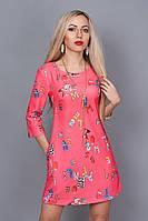 Модное  платье в цвете коралл с оригинальным рисунком из итальянского трикотажа