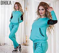 Женский спортивный костюм со вставками сетки