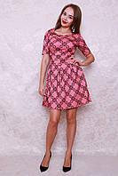 Красивое коктейльное платье модного фасона с пышной юбкой с рисунком флока
