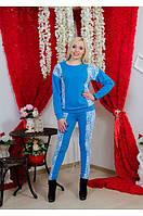 Женский трикотажный костюм с гипюром голубой