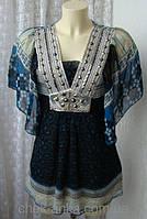 Спідниці, блузки та туніки жіночі