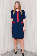 Платье изготовлено из ткани креп-дайвинг модного кроя