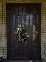 Металлические двери жатка со стеклопакетом и ковкой.