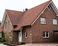 Покраска фасада кирпичного дома