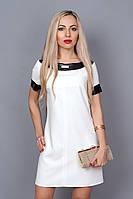 Красивое белое платье модного фасона с кожаными вставками