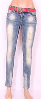 Женские джинсы с рванкой
