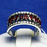 Серебряное кольцо с красными камнями 11044к