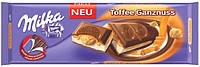 Milka Шоколад с лесными орехами и карамелью 300г