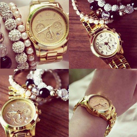 Часы Michael Kors и Rolex.