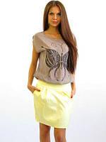 Яркая летняя юбка модной формы с карманами