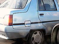 Молдинг оригинальный, самоклейка - на крышку люка боковины ЗАЗ-1103 Славута 1103-8212184 люкс / стандарт