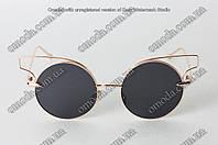 Круглые солнцезащитные очки с фигурной оправой