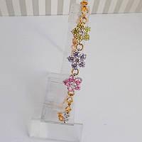 Браслет женский, позолота 18К + родий. Камни вставки: цветные цирконы.