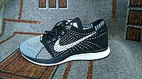 Мужские беговые кроссовки Flyknit Racer черные с белым