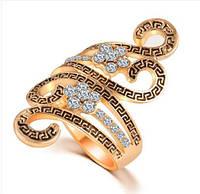 Позолоченное кольцо с цирконами р 18,19 код 958