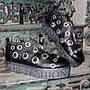 Женские кожаные черные туфли на утолщенной подошве, декорированы люверсами.