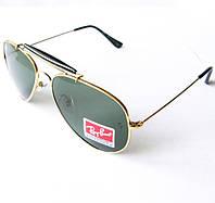 Скидка 30% на  мужские солнцезащитные очки Ray-Ban Outdoorsman в золотой оправе