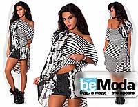 Модный женский костюм состоящий из свободной туники и коротких шортиков черно-белый