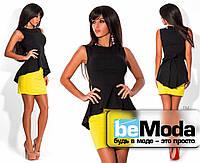 Милый женский костюм из черной блузы и яркой юбки черный с желтым