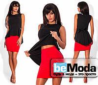 Милый женский костюм из черной блузы и яркой юбки черный с красным