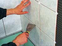 Укладка плитки с пола или стен