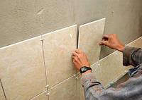 Облицовка стен ванной комнаты керамической плиткой