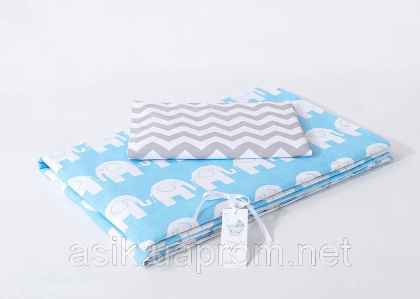 Детская сменная постель: слониками на голубом фоне и серый зигзаг