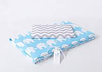 Детская сменная постель с слониками на голубом фоне