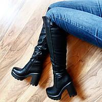 Женские кожаные демисезонные сапоги на каблуке