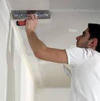 Стартовая шпатлевка потолка
