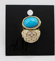 Набор позолоченных колец с голубым камнем и бежевым орнаментом в форме цветов от H&M