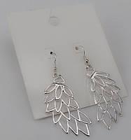 Серебристые женские серьги в форме крыльев от H&M
