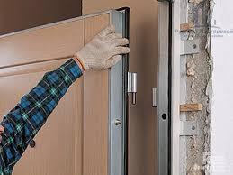 Установка дверного блока металлического с обвязкой