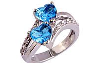 Кольцо, покрытое серебром с голубым топазом р 18 код 975