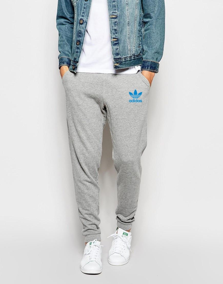 Мужские спортивные штаны Adidas серые с голубым принтом - Хайповый магаз.  Supreme Thrasher ASSC Palace 0ab2c961f75