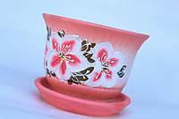 Цветочный горшок с розовыми цветами