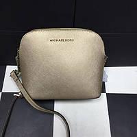 Золотая кожаная сумка-клатч Michael Kors