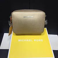 Золотая кожаная сумка-клатч Michael Kors. Натуральная кожа