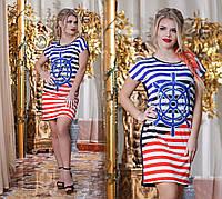 Женское платье-туника из комбинированной, ткани в полоску.