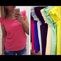 Трикотажная блузка с рюшами