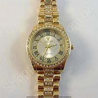 Часы Rolex 1083 (113857) женские золотистые с серебристым циферблатом в стразах римская цифра календарь