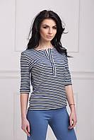 Молодежная женская блуза выполнена из мягкой трикотажной ткани в полоску