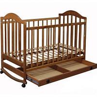 Кроватка  детска с ящиком и возможностью качания для новорожденного с полозьями резная ольха
