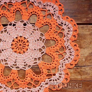 Вязаная салфетка круглая оранжевая меланж