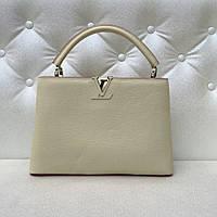 Женская кожаная сумка Louis Vuitton Capucines молочная