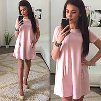 Платье-трапеция с украшением в зоне карманов